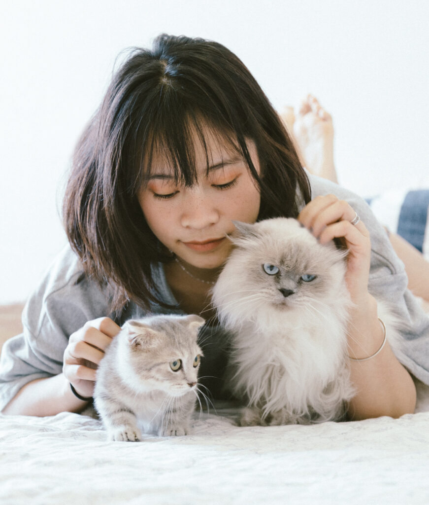 woman with two cats